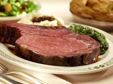 Prime rib dinner with mashed potatoes and creamed spinach