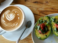 Latte and avocado split at Javista Organic Coffee Bar
