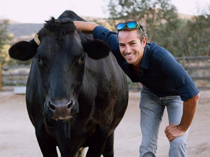 Bruno poses with a guest at Farm Sanctuary in Acton, California
