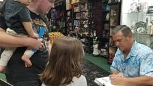 "Bruce Campbell signs ""Hail to the Chin"" at Dark Delicacies"